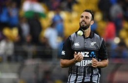 New Zealand's Daryl Mitchell looks on during the first Twenty20 cricket match between New Zealand and India in Wellington on February 6, 2019. (Photo by Marty MELVILLE / AFP)