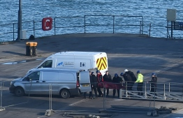 A body is taken off the Geo Ocean III, recovered from the wreckage of a plane carrying Argentine footballer Emiliano Sala at Weymouth harbour, south west England on February 7, 2019. - A body recovered by British investigators from the submerged wreckage of a plane that went down in the Channel has been identified as that of footballer Emiliano Sala, police said on February 7, 2019. The Argentine striker's body was first spotted by rescuers with a remotely operated vehicle (ROV) on Sunday close to where the plane went missing near the British island of Guernsey. (Photo by Glyn KIRK / AFP)