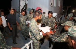 Dengue patient from Feeali, Faafu Atoll being brought aboard sea ambulance for transportation to the capital for treatment  PHOTO: MALDIVES NATIONAL DEFENCE FORCE (MNDF)