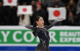 Rika Kihira of Japan celebrates after winning the Womens competition during the ISU Four Continents Figure Skating Championship at the Honda Center in Anaheim, California on February 8, 2019. (Photo by Mark RALSTON / AFP)