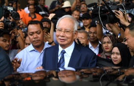 (FILES) In this file photo taken on December 12, 2018 former Malaysia's prime minister Najib Razak (C) leaves the courthouse in Kuala Lumpur after being charged. - Malaysia's disgraced ex-leader Najib Razak will go on trial over an extraordinary financial scandal that contributed to the downfall of his long-ruling coalition and has reverberated around the world. (Photo by Mohd RASFAN / AFP)