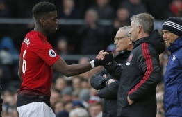 Manchester United's French midfielder Paul Pogba (L) shakes hands with Manchester United's  Norwegian caretaker manager Ole Gunnar Solskjaer after being substituted during the English Premier League football match between Fulham and Manchester United at Craven Cottage in London on February 9, 2019. (Photo by Ian KINGTON / AFP) / RESTRICTED TO EDITORIAL USE. No use with unauthorized audio, video, data, fixture lists, club/league logos or 'live' services. Online in-match use limited to 120 images. An additional 40 images may be used in extra time. No video emulation. Social media in-match use limited to 120 images. An additional 40 images may be used in extra time. No use in betting publications, games or single club/league/player publications. /