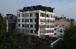A general view shows the Hotel Arpit Palace after a fire broke out on its premises in New Delhi on February 12, 2019. - At least 17 people died on February 12 as a fire tore through the budget hotel in Delhi before dawn, in the latest disaster to raise concerns over fire safety in India. (Photo by Prakash SINGH / AFP)