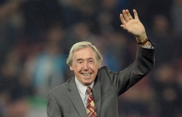 (FILES) In this file photo taken on October 27, 2015 Former England international footballer Gordon Banks waves to the fans ahead of the English League Cup fourth round football match between Stoke City and Chelsea at the Britannia Stadium in Stoke-on-Trent, central England on October 27, 2015. - Gordon Banks goalkeeper in England's 1966 World Cup victory over the then West Germany has died aged 81 his former club Stoke City announced on February 12, 2019. (Photo by OLI SCARFF / AFP) / RESTRICTED TO EDITORIAL USE. No use with unauthorized audio, video, data, fixture lists, club/league logos or 'live' services. Online in-match use limited to 75 images, no video emulation. No use in betting, games or single club/league/player publications. /