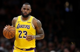 (FILES) In this file photo taken on February 06, 2019 BOSTON, MASSACHUSETTS - FEBRUARY 07: LeBron James #23 of the Los Angeles Lakers dribbles against the Boston Celtics during the second half at TD Garden 9 in Boston, Massachusetts. - LeBron James remains the top-earning player in the NBA while an increasing number of stars have boosted their income through off-field activities, a Forbes survey revealed February 12, 2019. Forbes said that Los Angeles Lakers star James was the highest-paid player in basketball for a fifth straight year, pocketing an estimated $88.7 million in 2018-2019. (Photo by Maddie Meyer / GETTY IMAGES NORTH AMERICA / AFP)