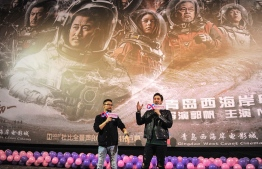 "This photo taken on February 17, 2019 shows film director Guo Fan (L) and American actor Michael Stephen Kai Sui attending a promotional event for Chinese sci-fi film ""The Wandering Earth"" in Qingdao in China's eastern Shandong province. - China's first large-scale sci-fi blockbuster has become the country's second highest-grossing movie ever, while claiming the Chinese film box-office champion in North America in the past five years. (Photo by STR / AFP) /"