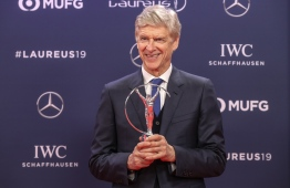 Winner of the Laureus Lifetime Achievement award, former Arsenal football team manager Arsene Wenger poses after receiving his award during the 2019 Laureus World Sports Awards ceremony at the Sporting Monte-Carlo complex in Monaco on February 18, 2019. (Photo by Valery HACHE / AFP)