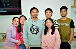 Manny Pacquiao, son Emmanuel Jr (6R) and family. PHOTO: MANNY PACQUIAO/TWITTER