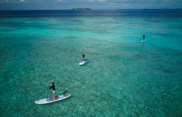 Dr Claire Petros, Dhafeena Hassan Ibrahim and Shaziya Saeed of the Stand Up for Our Seas team, on their paddleboards. PHOTO/STAND UP FOR OUR SEAS