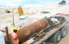 A large amount of marine debris and a 10-foot pillar removed from Raalhugandu. PHOTO: ALI AHSAN/COOKIE PICTURE