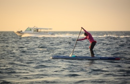 Dhafy of the Stand Up for Our Seas team on her SUP. PHOTO: JAMES APPLETON/ STAND UP FOR OUR SEAS