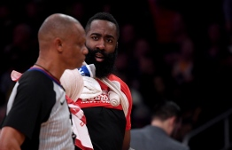 "(FILES) In this file photo taken on February 20, 2019, James Harden #13 of the Houston Rockets argues with referee Michael Smith #38 after getting three fouls during the first quarter in a 111-106 loss to the Los Angeles Lakers at Staples Center on February 21, 2019 in Los Angeles, California. - Houston Rockets guard James Harden was fined $25,000 by the NBA on February 23, 2019, for public criticism of officiating, the league announced. Harden made his comments to reporters after the Los Angeles Lakers defeated the visiting Rockets 111-106 on Thursday at Staples Center. Referee Scott Foster aroused Harden's anger, the versatile All-Star saying Foster has a ""personal"" issue with the Rockets and should not be permitted to officiate any more of their games. (Photo by Harry How / GETTY IMAGES NORTH AMERICA / AFP)"