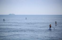 The four as seen paddling through Baa Atoll. PHOTO: JAMES APPLETON