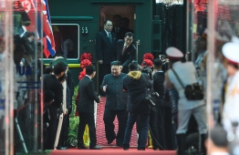 North Korean leader Kim Jong Un (C) arrives at the Dong Dang railway station in Dong Dang, Lang Son province, on February 26, 2019, to attend the second US-North Korea summit. - North Korean leader Kim Jong Un crossed into Vietnam on February 26 after a marathon train journey for a second summit showdown with Donald Trump, with the world looking for concrete progress over the North's nuclear programme. (Photo by Nhac NGUYEN / AFP)