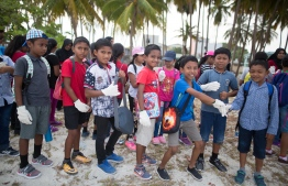 Students of Baa Atoll Education Centre participating in a beach clean-up. PHOTO: JAMES APPLETON PHOTOGRAPHY/ STAND UP FOR OUR SEAS