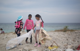 Students participating in a clean-up of Eydhafushi beach. PHOTO: JAMES APPLETON PHOTOGRAPHY/ STAND UP FOR OUR SEAS