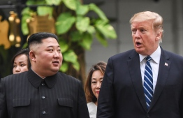 US President Donald Trump (R) walks with North Korea's leader Kim Jong Un during a break in talks at the second US-North Korea summit at the Sofitel Legend Metropole hotel in Hanoi on February 28, 2019. (Photo by Saul LOEB / AFP)
