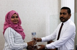 High Court Chief Judge Shujau Usman gifting glass water bottles to administrative officers. PHOTO: HIGH COURT