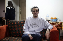 Egyptian photojournalist Mahmoud Abu Zeid, widely known as Shawkan, is pictured at his home in the capital Cairo on March 4, 2019. - Award-winning Egyptian photojournalist Mahmoud Abu Zeid, widely known as Shawkan, was released from jail on March 4, 2019 after spending nearly six years in prison, his lawyer said. Shawkan, who last year received UNESCO's World Freedom Prize, was arrested in 2013 while he was covering August clashes between security forces and supporters of ousted Islamist president Mohamed Morsi. (Photo by MOHAMED EL-RAAI / AFP)