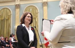 (FILES) In this file photo taken on November 4, 2015 Canada's new Health Minister Jane Philpott is sworn-in during a ceremony at Rideau Hall in Ottawa. - Canadian Budget Minister Jane Philpott resigned on March 4, 2019, saying she no longer had confidence in Prime Minister Justin Trudeau's government, which is embroiled in a major political crisis. (Photo by CHRIS WATTIE / POOL / AFP)