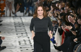 British fashion designer Stella McCartney acknowledges the audience at the end of the Stella McCartney Fall-Winter 2019/2020 Ready-to-Wear collection fashion show in Paris, on March 4, 2019. (Photo by Philippe LOPEZ / AFP)