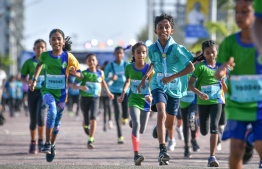 Kids take part in the 'KidSmile' category on the final day of the Maldives International Marathon. PHOTO: NISHAN ALI/MIHAARU