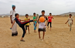 Displaced Yemeni children from the province of Hodeidah play football in a makeshift camp in the northern district of Abs in Yemen's northwestern Hajjah province, on March 06, 2019. (Photo by ESSA AHMED / AFP)