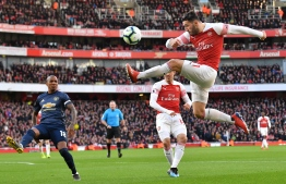 Arsenal's German-born Bosnian defender Sead Kolasinac (R) plays the ball during the English Premier League football match between Arsenal and Manchester United at the Emirates Stadium in London on March 10, 2019. (Photo by Ben STANSALL / AFP) / RESTRICTED TO EDITORIAL USE. No use with unauthorized audio, video, data, fixture lists, club/league logos or 'live' services. Online in-match use limited to 120 images. An additional 40 images may be used in extra time. No video emulation. Social media in-match use limited to 120 images. An additional 40 images may be used in extra time. No use in betting publications, games or single club/league/player publications. /