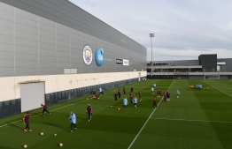 Manchester City players team attend a team training session at City Football Academy in Manchester, north west England on March 11, 2019 on the eve of their Champions League round of 16, second leg football match against FC Schalke. (Photo by Paul ELLIS / AFP)