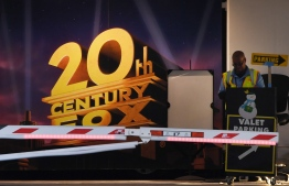 """(FILES) In this file photo taken on December 13, 2017 the Fox Studios are seen in West Los Angeles, California. - Walt Disney Co. said March 12, 2019 it would close its blockbuster deal for the film and television assets of 21st Century Fox on March 20, a deal likely to reshape the media-entertainment landscape. The $71 billion deal gives Disney the prized 20th Century Fox studios and other media production units.It also vastly reduces the empire of media mogul Rupert Murdoch and his family, who are planning a """"new Fox"""" that includes the US broadcast network and the Fox News Channel. (Photo by Mark RALSTON / AFP)"""