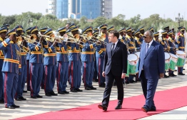 French president Emmanuel Macron (2nd R) is welcomed by Djibouti president Ismail Omar Guelleh (R) during an official military welcome ceremony at the presidential palace in Djibouti on March 12, 2019. French President Macron tours Horn of Africa nations, with stops in Djibouti, Ethiopia and Kenya. Ludovic MARIN / POOL / AFP
