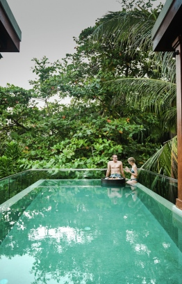 A couple lounging in the pool at the SkyHouse with Bubble in Amilla Fushi Resort. PHOTO: AMILLA FUSHI RESORT