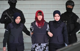 Vietnamese national, Doan Thi Huong (C) leaves Shah Alam High Court escorted by Malaysian police, outside Kuala Lumpur on March 14, 2019. - A Vietnamese woman charged with assassinating the North Korean leader's half-brother lost her bid for immediate release March 14 as Malaysian authorities refused to drop a murder charge, days after her Indonesian co-accused was freed. (Photo by MOHD RASFAN / AFP)