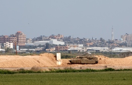 A picture taken on March 15, 2019, shows an Israeli Merkava battle tank near the border with the Gaza Strip near the Kibbutz of Nahal Oz in southern Israel. - Weekly protests along the Gaza-Israel border were called off on March 15 after a military escalation between the Jewish state and the Palestinian territory's Islamist rulers Hamas, organisers announced. The cancellation, the first of its kind in a year, came after Israel said its aircraft struck dozens of Hamas targets in Gaza overnight in response to rockets fired from the enclave, including at Tel Aviv. (Photo by JACK GUEZ / AFP)