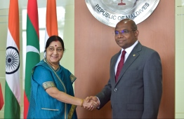 Foreign Minister Abdulla Shahid (L) greets India's Minister of External Affairs Sushma Swaraj on her official visit to Maldives on March 17, 2019. PHOTO: HUSSAIN WAHEED/MIHAARU