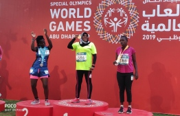 Gold Medalist Shifna Ibrahim (C) at the Special Olympics World Games. PHOTO: MINISTRY OF YOUTH, SPORTS AND COMMUNITY DEVELOPMENT