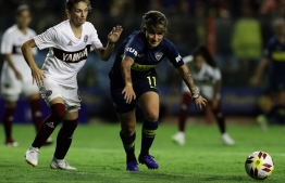 Boca Juniors' Yamila Rodriguez (R) and Lanus' midfielder Vanina Garcia Cueva, vie for the ball during a Women's League football match to commemorate the International Women's Day, at the La Bombonera stadium before the Superliga Argentina football match between Boca Juniors and San Lorenzo, in Buenos Aires, on March 9, 2019. PHOTO: ALEJANDRO PAGNI / AFP