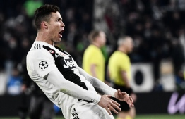 Juventus' Portuguese forward Cristiano Ronaldo celebrates after scoring 3-0 during the UEFA Champions League round of 16 second-leg football match Juventus vs Atletico Madrid on March 12, 2019 at the Juventus stadium in Turin. PHOTO: MARCO BERTORELLO / AFP