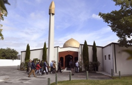 Members of the local Muslim community enter the Al Noor mosque after is was reopened in Christchurch on March 23, 2019. - Muslims returned on March 23 to Christchurch's main mosque for the first time since a white supremacist launched a massacre of 50 worshippers there, as New Zealand sought to return to normal following the searing tragedy. (Photo by WILLIAM WEST / AFP)