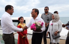 Abdul Mughunee (L) greets former President Mohamed Nasheed upon his arrival at GDh.Thinadhoo. PHOTO/MDP