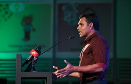 Vice President Faisal Naseem speaking at Faris Maumoon's campaign rally for the upcoming parliamentary elections. PHOTO: HUSSAIN WAHEED / MIHAARU