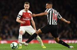 Arsenal's Welsh midfielder Aaron Ramsey (L) vies with Newcastle United's English midfielder Isaac Hayden during the English Premier League football match between Arsenal and Newcastle United at the Emirates Stadium in London on April 1, 2019. (Photo by Glyn KIRK / AFP) / RESTRICTED TO EDITORIAL USE. No use with unauthorized audio, video, data, fixture lists, club/league logos or 'live' services. Online in-match use limited to 120 images. An additional 40 images may be used in extra time. No video emulation. Social media in-match use limited to 120 images. An additional 40 images may be used in extra time. No use in betting publications, games or single club/league/player publications. /