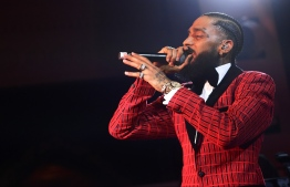 (FILES) In this file photo taken on February 07, 2019 Nipsey Hussle performs onstage at the Warner Music Pre-Grammy Party at the NoMad Hotel in Los Angeles. - Grammy-nominated rapper Nipsey Hussle was fatally shot in the US city of Los Angeles on Sunday March 31, 2019, NBC News reported, citing law enforcement sources. (Photo by Matt Winkelmeyer / GETTY IMAGES NORTH AMERICA / AFP)