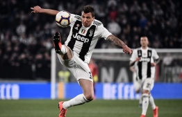 Juventus' Croatian forward Mario Mandzukic controls the ball during the Italian Serie A football match Juventus vs Empoli on March 30, 2019 at the Juventus stadium in Turin. (Photo by Marco BERTORELLO / AFP)