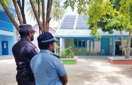 Two police officers operating in polling stations of Villingili, Gaafu Alif Atoll. PHOTO: POLICE MEDIA