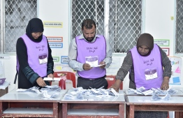 Elections Commission Officials counting ballot papers in a polling station. PHOTO: NISHAN ALI / MIHAARU