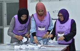 Election officials count ballot boxes after voting closes in the 2019 Parliamentary Election. PHOTO: NISHAN ALI / MIHAARU