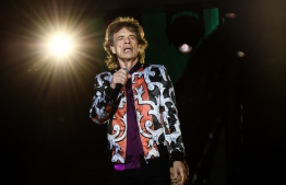 "(FILES) In this file photo taken on June 26, 2018, British musician Mick Jagger of The Rolling Stones performs during a concert at The Velodrome Stadium in Marseille as part of their 'No Filter' tour. - Mick Jagger is ""on the mend"" after a reportedly successful heart valve procedure in New York, the Rolling Stones frontman said Friday, April 5, 2019. ""Thank you everyone for all your messages of support, I'm feeling much better now and on the mend - and also a huge thank you to all the hospital staff for doing a superb job,"" said Jagger, 75. Industry tracker Billboard had earlier said doctors performed a minimally invasive transcatheter aortic valve replacement. (Photo by Boris HORVAT / AFP)"