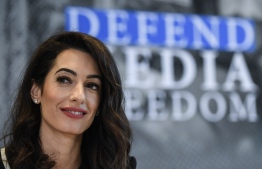 Lebanese-British human-rights lawyer Amal Clooney holds a press briefing on his Media Freedom Campaign on April 5, 2019 in Dinard, western France, in the margins of the G7 Foreign ministers meeting to prepare the G7 Summit in Biarritz which will take place from August 25 to 27, 2019. (Photo by Damien MEYER / AFP)