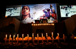 Dozens of Ethiopian and Eritrean living in Addis Ababa gather for the memorial service to honor Eritrean American rapper, Nipsey Hussle, on April 6, 2019  in Addis Ababa. - Rapper Nipsey Hussle died Sunday March 31, 2019 after a shooting in Los Angeles near a clothing store he owned. (Photo by Michael TEWELDE / AFP)